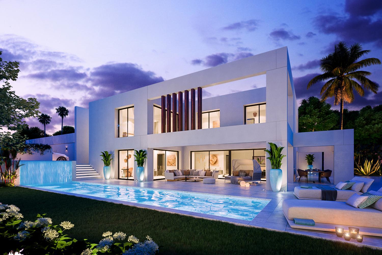 La villa dispose d'un grand jardin avec une piscine à débordement